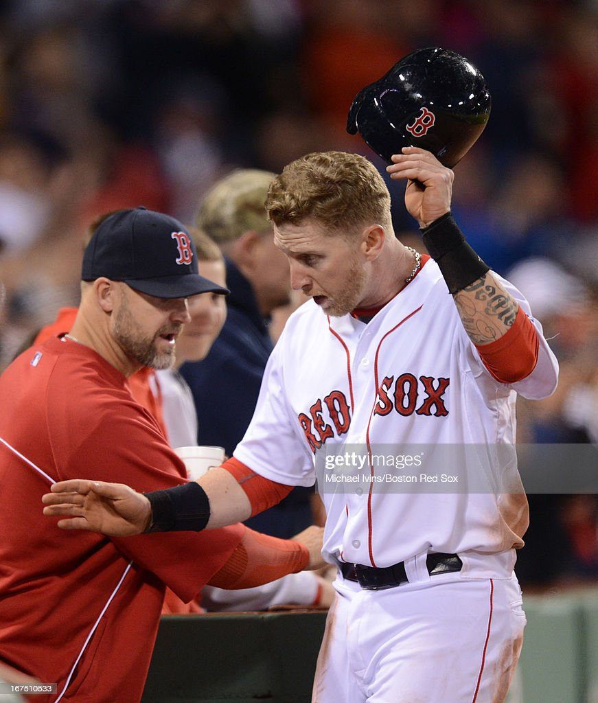 Mike Carp #37 of the Boston Red Sox is congratulated by by teammates after scoring a run against the Houston Astros in the fifth inning on April 25, 2013 at Fenway Park in Boston, Massachusetts.