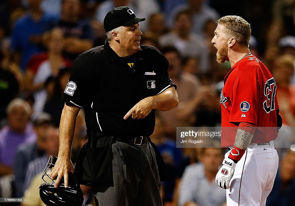 Mike Carp #37 of the Boston Red Sox is ejected by umpire Bill Welke #52 after arguing a third strike in the 7th inning against the New York Yankees at Fenway Park on August 16, 2013 in Boston, Massachusetts.