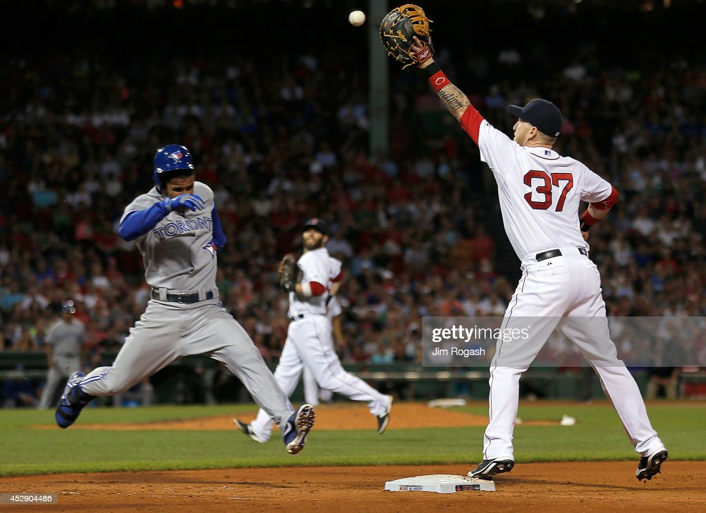 Mike Carp #37 of the Boston Red Sox makes the out on <a gi-track='captionPersonalityLinkClicked' href=/galleries/search?phrase=Anthony+Gose&family=editorial&specificpeople=6906091 ng-click='$event.stopPropagation()'>Anthony Gose</a> #8 of the Toronto Blue Jays at first base in the sixth inning at Fenway Park on July 29, 2014 in Boston, Massachusetts.