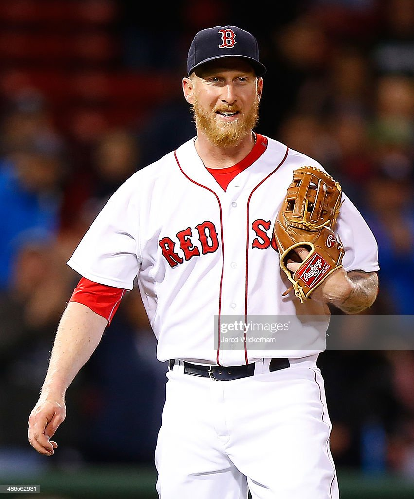 Mike Carp #37 of the Boston Red Sox pitches against the New York Yankees in the ninth inning during the game at Fenway Park on April 24, 2014 in Boston, Massachusetts.