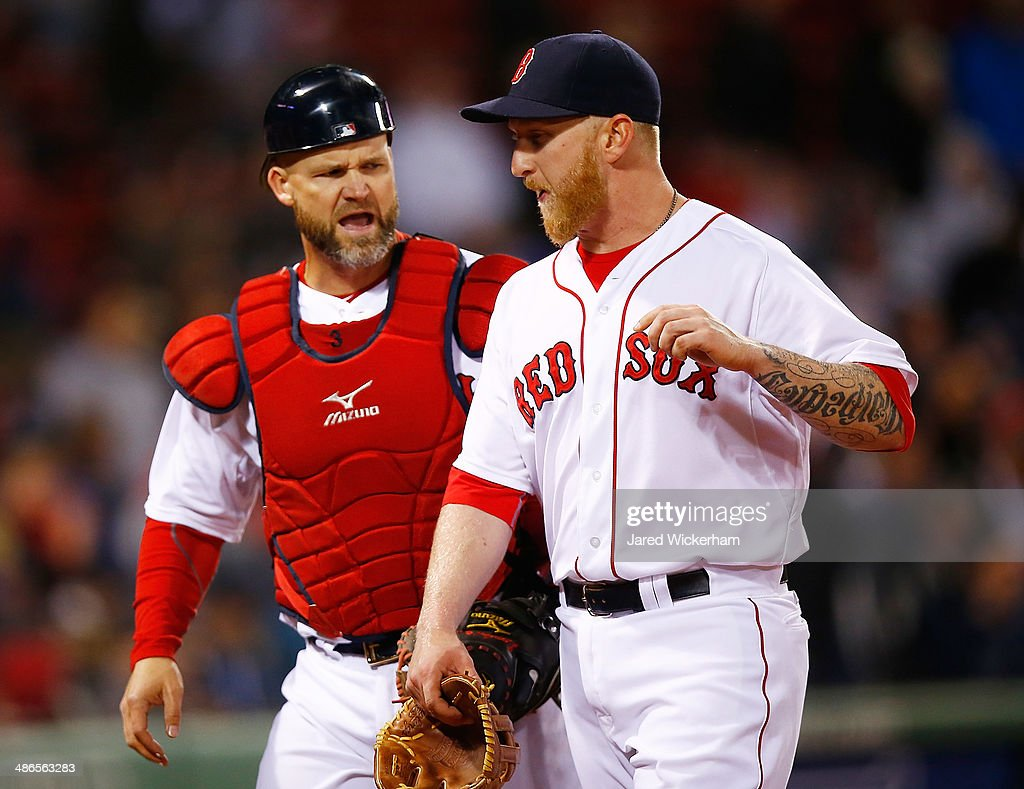 Mike Carp #37 of the Boston Red Sox talks with teammate <a gi-track='captionPersonalityLinkClicked' href=/galleries/search?phrase=David+Ross&family=editorial&specificpeople=210843 ng-click='$event.stopPropagation()'>David Ross</a> #3 after pitching in the 9th inning against the New York Yankees during the game at Fenway Park on April 24, 2014 in Boston, Massachusetts.