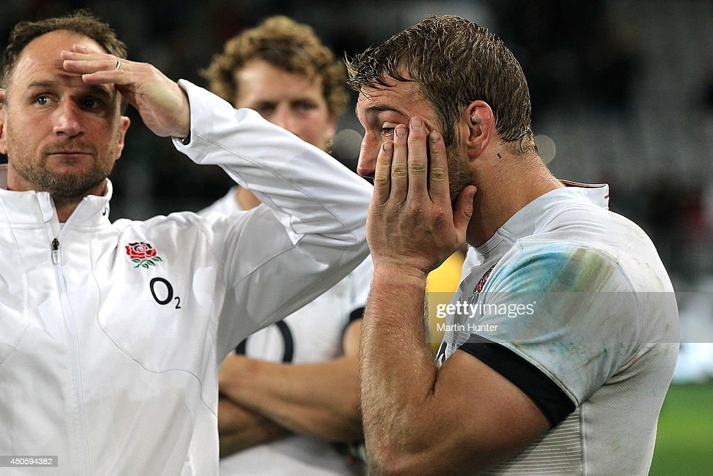 Mike Catt, Billy Twelvetrees and Chris Robshaw react after the International Test Match between the New Zealand All Blacks and England at Forsyth Barr Stadium on June 14, 2014 in Dunedin, New Zealand.