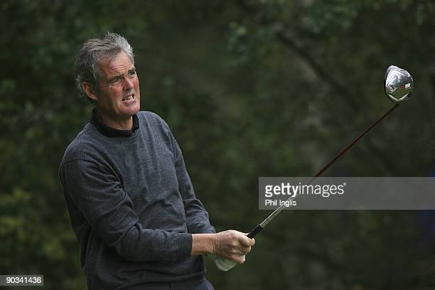 Mike Clayton of Australia in action during the first round of the Travis Perkins plc Senior Masters played at the Duke's Course Woburn Golf Club on...