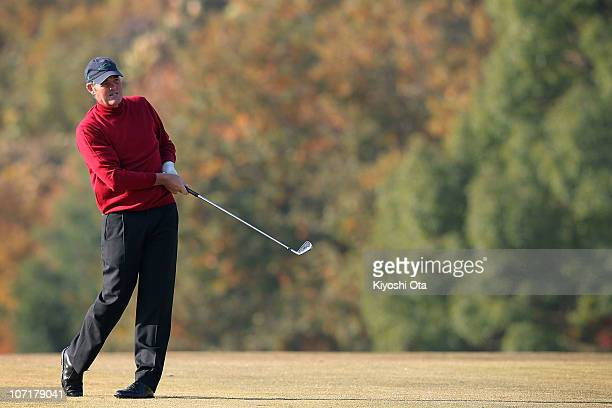 Mike Clayton of Australia plays an approach shot on the 3rd hole during day four of the 2010 Handa Cup Senior Masters at Ohmurasaki Golf Club on...