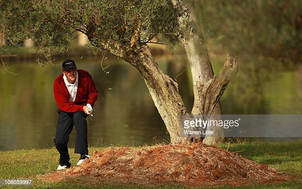 Mike Clayton of the USA plays his second shot from behind a tree on the fifth hole during the first round of the OKI Castellon Senior Tour...