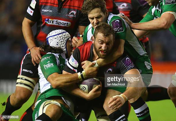 Mike Coman of Edinburgh Rugby is tackled by Blair Cowan of London Irish during the European Rugby Challenge Cup match between Edinburgh Rugby and...
