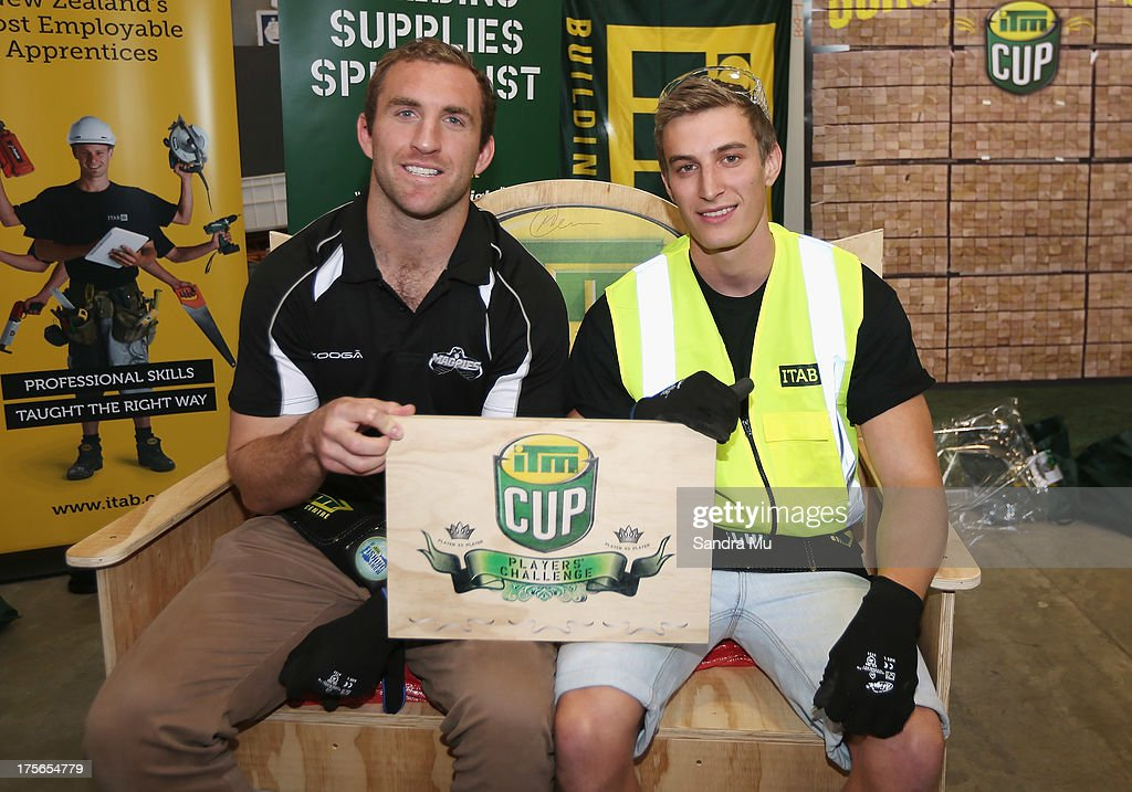 Mike Coman of Hawkes Bay (L) and his apprentice Clark Wondergem hold the plaque for winning the challenge during the 2013 launch of the ITM Cup at Unitec on August 6, 2013 in Auckland, New Zealand.