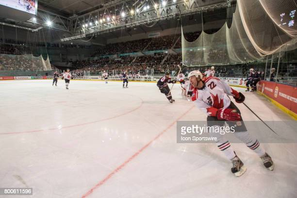 Mike Commodore of Team Canada turns away from goal after a successful Team USA goal during the Melbourne Game of the Ice Hockey Classic on June 24...