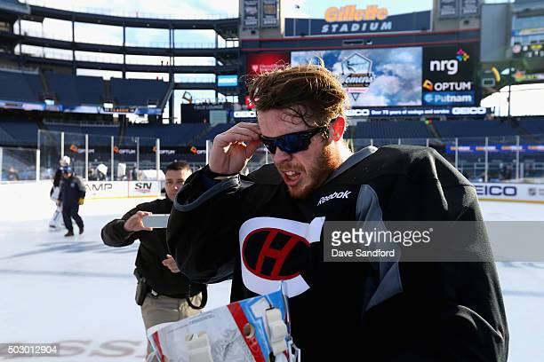 Mike Condon of the Montreal Canadiens attends practice wearing sunglasses for the 2016 Bridgestone NHL Classic at Gillette Stadium on December 31...