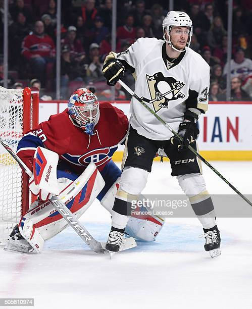 Mike Condon of the Montreal Canadiens defends the goal against Tom Kuhnhackl of the Pittsburgh Penguins in the NHL game at the Bell Centre on January...