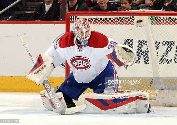 Mike Condon of the Montreal Canadiens gets ready to make a save against the Arizona Coyotes at Gila River Arena on February 15 2016 in Glendale...