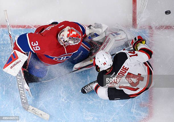Mike Condon of the Montreal Canadiens stops a shot by Adam Henrique of the New Jersey Devils in the NHL game at the Bell Centre on November 28 2015...