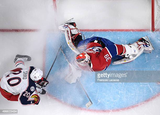 Mike Condon of the Montreal Canadiens stops a shot by Brandon Saad of the Columbus Blue Jackets in the NHL game at the Bell Centre on December 1 2015...