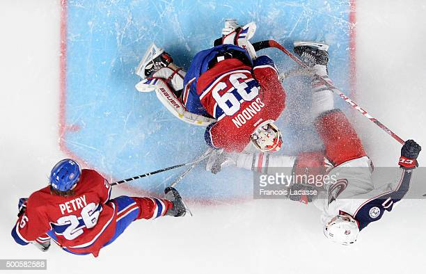 Mike Condon of the Montreal Canadiens stops a shot by Matt Calvert of the Columbus Blue Jackets in the NHL game at the Bell Centre on December 1 2015...