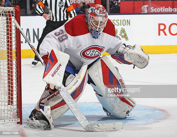 Mike Condon of the Montreal Canadiens watches for a shot against the Toronto Maple Leafs during an NHL game at the Air Canada Centre on January...