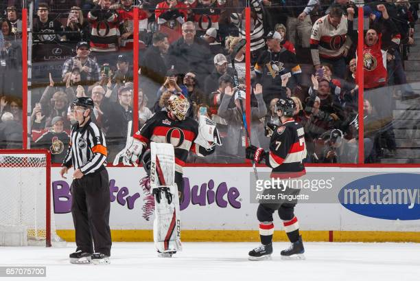 Mike Condon of the Ottawa Senators celebrates his shootout win over the Pittsburgh Penguins with teammate Kyle Turris at Canadian Tire Centre on...