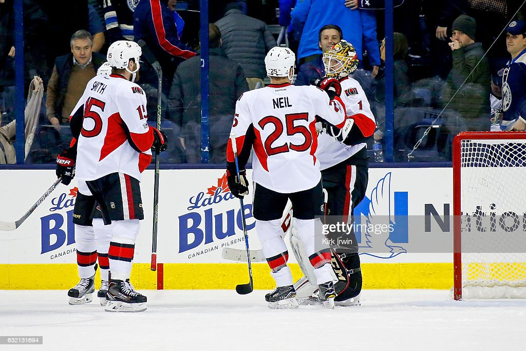 Mike Condon #1 of the Ottawa Senators is congratulated by Chris Neil #25 of the Ottawa Senators after defeating the Columbus Blue Jackets 2-0 on January 19, 2017 at Nationwide Arena in Columbus, Ohio.