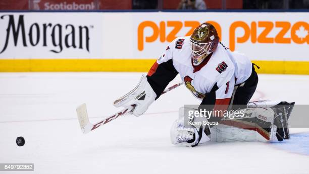Mike Condon of the Ottawa Senators makes a save against the Toronto Maple Leafs during the second period at the Air Canada Centre in their preseason...