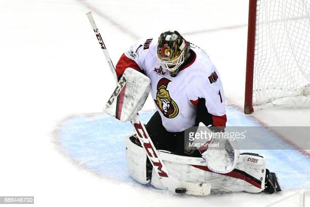 Mike Condon of the Ottawa Senators makes a stick save against the Pittsburgh Penguins during the second period in Game Five of the Eastern Conference...