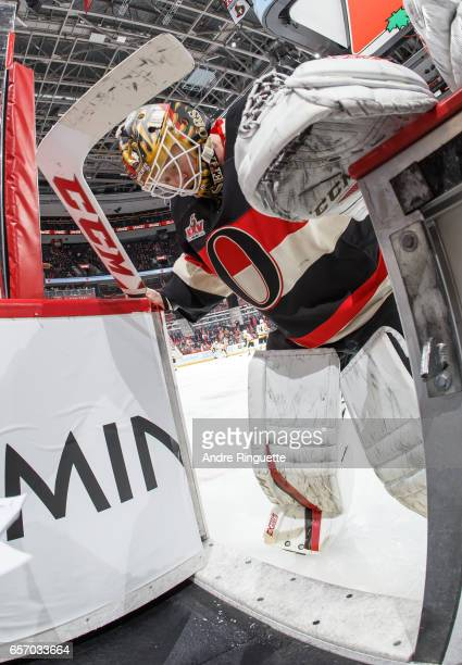Mike Condon of the Ottawa Senators makes some equipment adjustments in the doorway of the players' bench during warmup prior to his start against the...