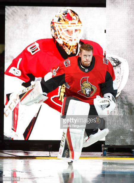 Mike Condon of the Ottawa Senators steps onto the ice during player introductions prior to the home opener against the Washington Capitals at...
