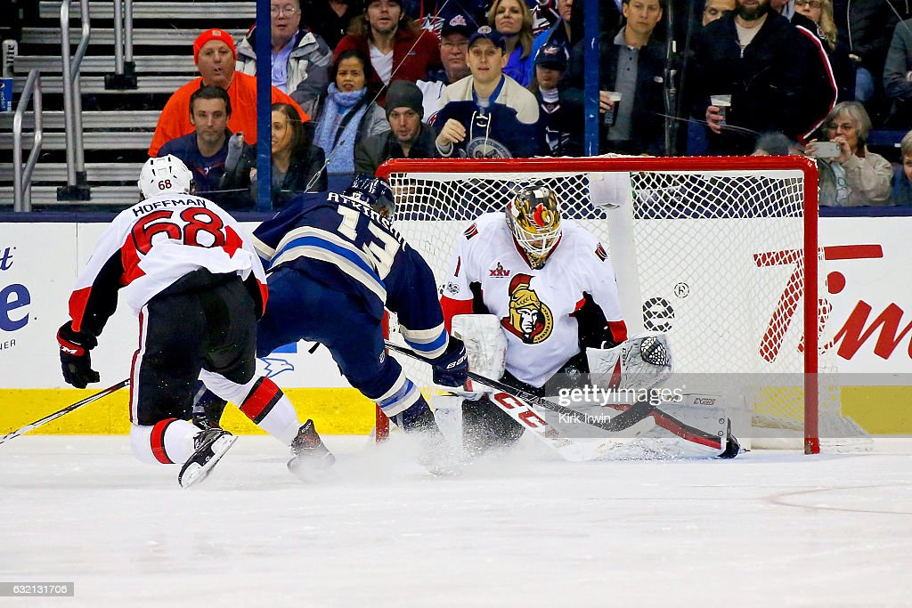 Mike Condon #1 of the Ottawa Senators stops a shot from Cam Atkinson #13 of the Columbus Blue Jackets as Mike Hoffman #68 of the Ottawa Senators skates back on defense during the third period on January 19, 2017 at Nationwide Arena in Columbus, Ohio. Ottawa defeated Columbus 2-0.