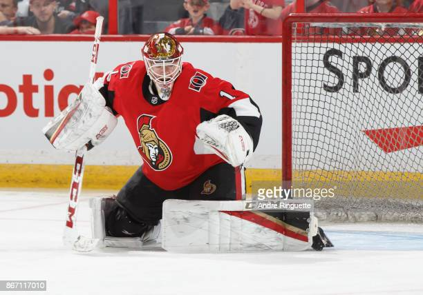 Mike Condon of the Ottawa Senators tends net during warmup prior to a game against the Los Angeles Kings at Canadian Tire Centre on October 24 2017...