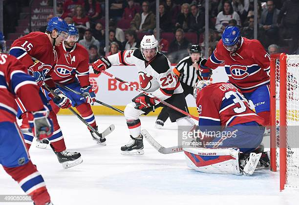 Mike Condon Tomas Fleischmann Andrei Markov and PK Subban of the Montreal Canadiens defend the goal against Bobby Farnham of the New Jersey Devils in...