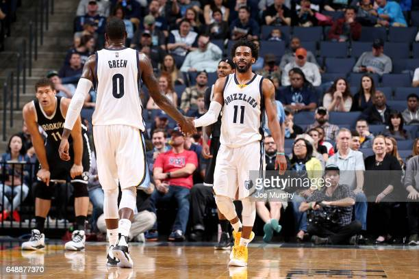 Mike Conley and JaMychal Green of the Memphis Grizzlies high five each other during the game against the Brooklyn Nets on March 6 2017 at FedExForum...