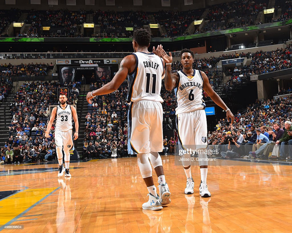 Mike Conley #11 and <a gi-track='captionPersonalityLinkClicked' href=/galleries/search?phrase=Mario+Chalmers&family=editorial&specificpeople=802115 ng-click='$event.stopPropagation()'>Mario Chalmers</a> #6 of the Memphis Grizzlies give each other high fives during the game against the Dallas Mavericks on November 24, 2015 at FedEx Forum in Memphis, Tennessee.