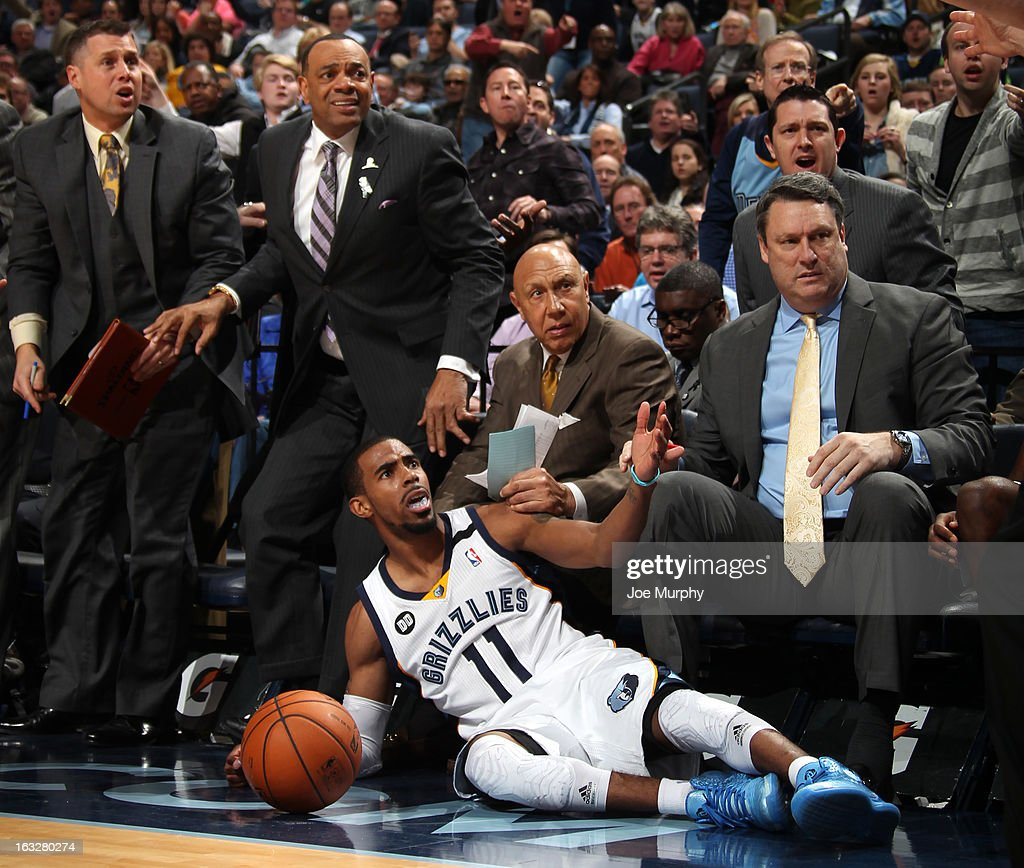 Mike Conley #11 and the coaching staff of the Memphis Grizzlies reacts to a call against the Portland Trail Blazers on March 6, 2013 at FedExForum in Memphis, Tennessee.