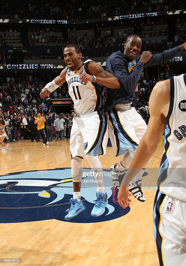 Mike Conley #11 and Tony Wroten #1 of the Memphis Grizzlies celebrate after defeating the Oklahoma City Thunder on March 20, 2013 at FedExForum in Memphis, Tennessee.