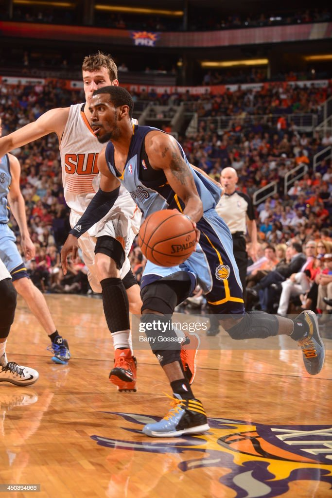 Mike Conley #11 drives against the Pheonix Suns on April 14, 2014 at U.S. Airways Center in Phoenix, Arizona.