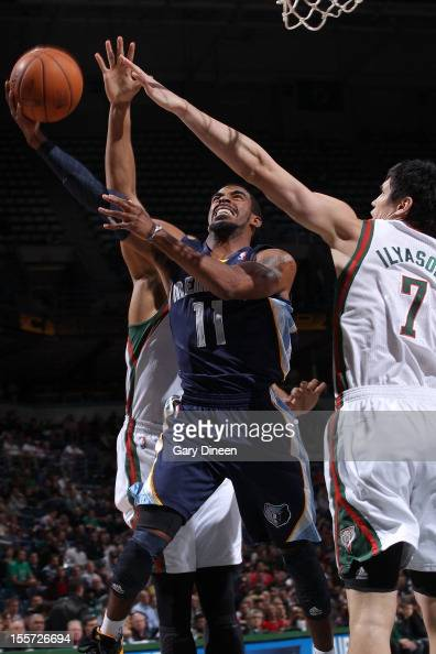 Mike Conley Jr #11 of the Memphis Grizzlies shoots against Tobias Harris and Ersan Ilyasova of the Milwaukee Bucks during the NBA game on November 6...