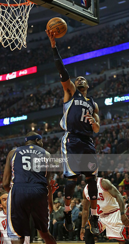 Mike Conley #11 of the Memphis Grizzles puts up a shot over teammate Zach Randolph #50 against the Chicago Bulls at the United Center on January 19, 2013 in Chicago, Illinois. The Grizzlies defeated the Bulls 85-82 in overtime.