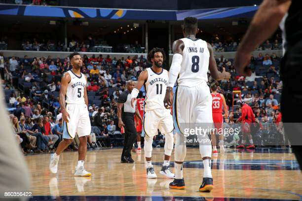 Mike Conley of the Memphis Grizzlies and James Ennis III of the Memphis Grizzlies celebrate during a preseason game against the Houston Rockets on...