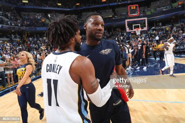 Mike Conley of the Memphis Grizzlies and Tony Allen of the New Orleans Pelicans after the game on October 18 2017 at FedExForum in Memphis Tennessee...