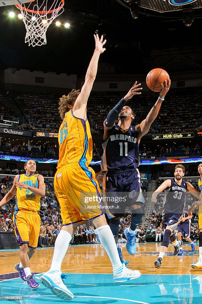 Mike Conley #11 of the Memphis Grizzlies attempts a layup against <a gi-track='captionPersonalityLinkClicked' href=/galleries/search?phrase=Robin+Lopez&family=editorial&specificpeople=2351509 ng-click='$event.stopPropagation()'>Robin Lopez</a> #15 of the New Orleans Hornets on March 22, 2013 at the New Orleans Arena in New Orleans, Louisiana.