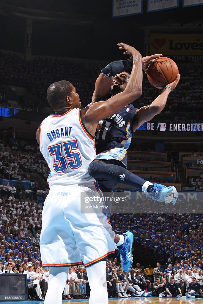 Mike Conley #11 of the Memphis Grizzlies attempts to shoot over <a gi-track='captionPersonalityLinkClicked' href=/galleries/search?phrase=Kevin+Durant&family=editorial&specificpeople=3847329 ng-click='$event.stopPropagation()'>Kevin Durant</a> #35 of the Oklahoma City Thunder in Game Two of the Western Conference Semifinals during the 2013 NBA Playoffs on May 7, 2013 at the Chesapeake Energy Arena in Oklahoma City, Oklahoma.