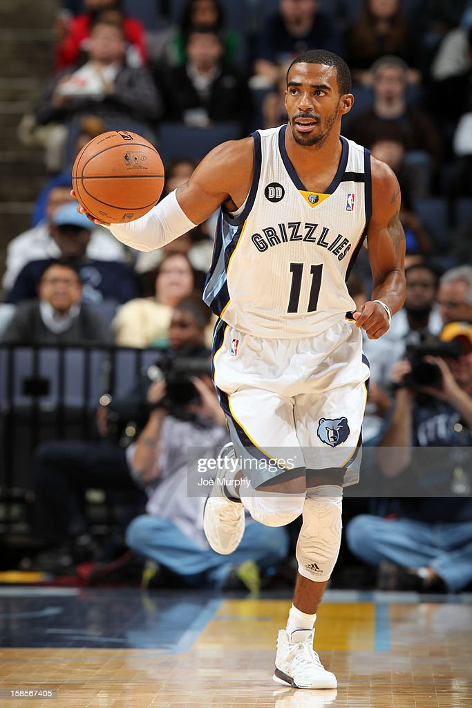 Mike Conley #11 of the Memphis Grizzlies brings the ball up court against the Chicago Bulls on December 17, 2012 at FedExForum in Memphis, Tennessee.