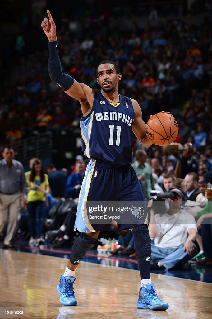 Mike Conley #11 of the Memphis Grizzlies brings the ball up court against the Denver Nuggets on March 15, 2013 at the Pepsi Center in Denver, Colorado.