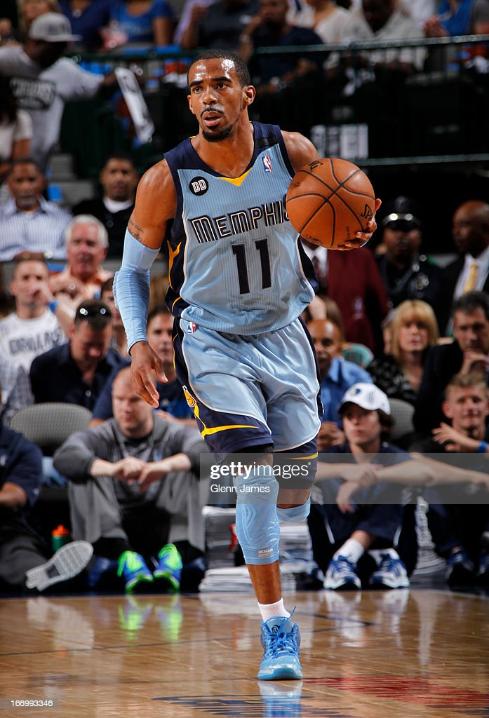 Mike Conley #11 of the Memphis Grizzlies brings the ball up court against the Dallas Mavericks on April 15, 2013 at the American Airlines Center in Dallas, Texas.