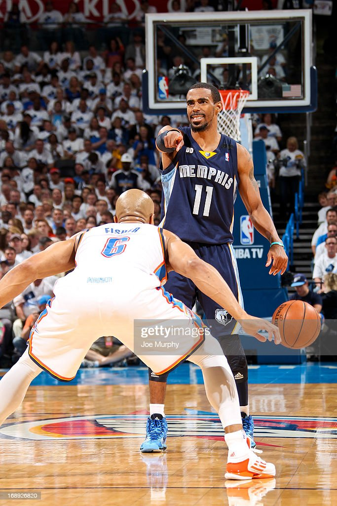 Mike Conley #11 of the Memphis Grizzlies calls out a play to his teammates against Derek Fisher #6 of the Oklahoma City Thunder in Game Five of the Western Conference Semifinals during the 2013 NBA Playoffs on May 15, 2013 at the Chesapeake Energy Arena in Oklahoma City, Oklahoma.