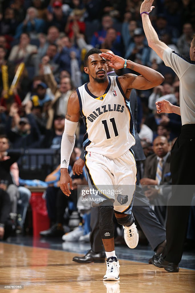 Mike Conley #11 of the Memphis Grizzlies celebrates a three point basket during a game against the Denver Nuggets on December 28, 2013 at FedExForum in Memphis, Tennessee.
