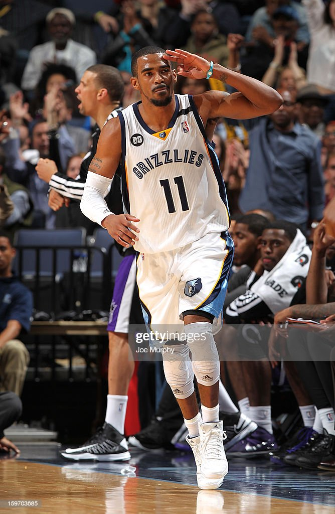 Mike Conley #11 of the Memphis Grizzlies celebrates after making a three-pointer against the Sacramento Kings on January 18, 2013 at FedExForum in Memphis, Tennessee.
