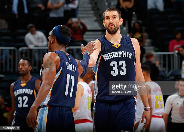 Mike Conley of the Memphis Grizzlies congratulates Marc Gasol in the final seconds of their 8281 win over the Atlanta Hawks at Philips Arena on...