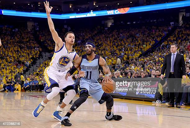 Mike Conley of the Memphis Grizzlies controls the ball against Stephen Curry of the Golden State Warriors in the first quarter of Game Two of the...