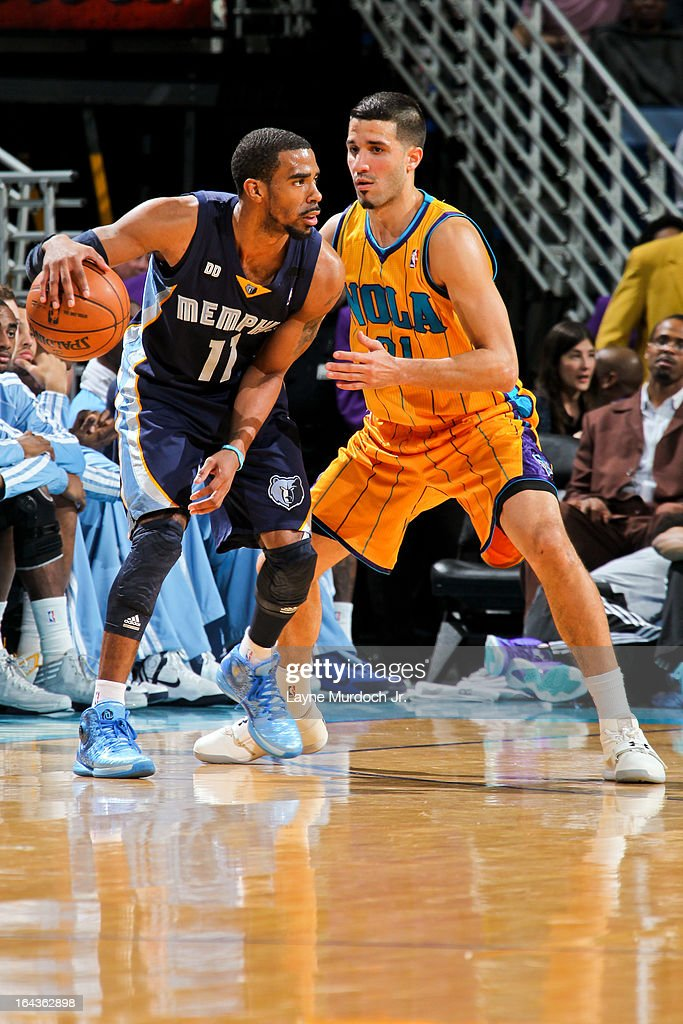 Mike Conley #11 of the Memphis Grizzlies controls the ball against <a gi-track='captionPersonalityLinkClicked' href=/galleries/search?phrase=Greivis+Vasquez&family=editorial&specificpeople=4066977 ng-click='$event.stopPropagation()'>Greivis Vasquez</a> #21 of the New Orleans Hornets on March 22, 2013 at the New Orleans Arena in New Orleans, Louisiana.