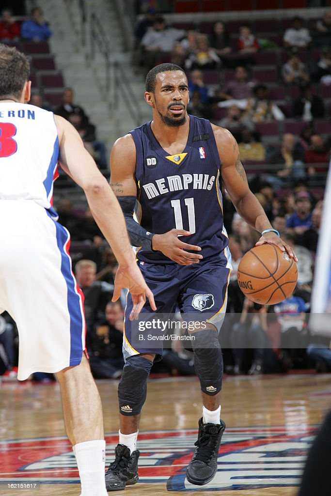 Mike Conley #11 of the Memphis Grizzlies controls the ball against the Detroit Pistons on February 19, 2013 at The Palace of Auburn Hills in Auburn Hills, Michigan.
