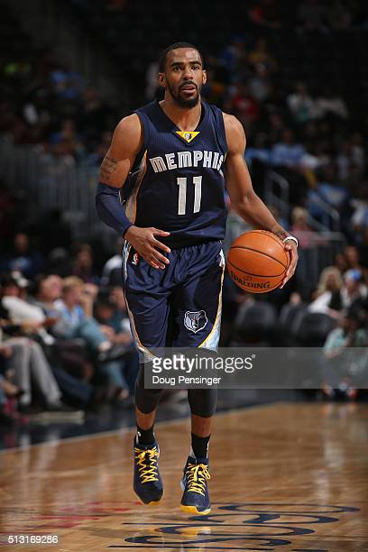 Mike Conley of the Memphis Grizzlies controls the ball against the Denver Nuggets at Pepsi Center on February 29 2016 in Denver Colorado The...